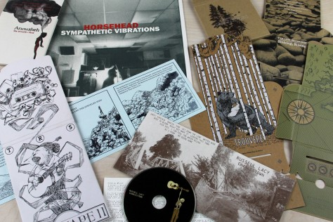 """Custom Screen Printed Music Packaging for CD, Vinyl, Cassette Tapes, and other Media Formats. LP and 7"""" jackets, CD sleeves, wallets, and Arigato Paks."""